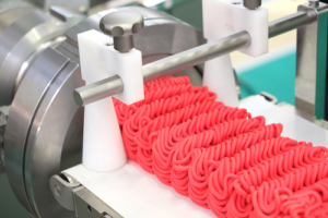 Machine processing meat