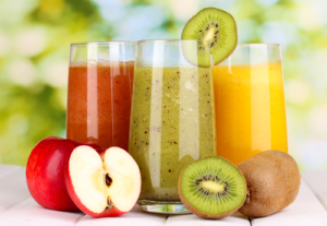 Apple, Kiwi and Orange fruit and Fruit Juices in Glasses